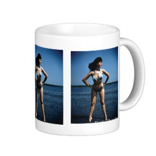 Bettie Page in a Blue Bikini Standing Beside Water Mugs