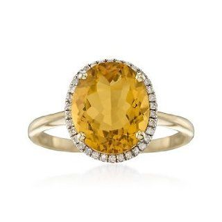 4.20 Carat Oval Citrine and Diamond Ring in 14kt Yellow Gold. Size 7 Jewelry