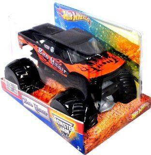 "Hot Wheels Monster Jam 124 Scale Die Cast Metal Body Official Monster Truck 2011 Series #T8523   Joe Sylvester BAD HABIT with Monster Tires, Working Suspension and 4 Wheel Steering (Dimension  7"" L x 5 1/2"" W x 4 1/2"" H) Toys & Games"