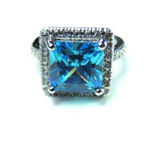 Jules Cocktail Ring Princess Cut Aquamarine Blue Cubic Zirconia 18K White Gold Plated Ginger Lyne Collection Jewelry