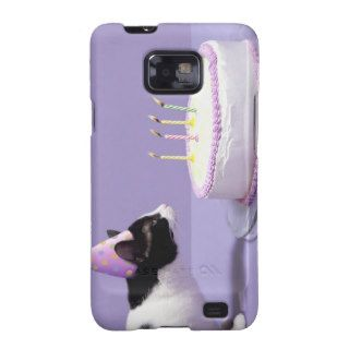 Cat wearing birthday hat blowing out candles on samsung galaxy SII covers